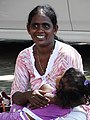 Woman with Child - Fort District - Galle - Sri Lanka (14043486412).jpg