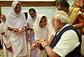 Women tying 'Rakhi' on the Prime Minister, Shri Narendra Modi's wrist, on the occasion of 'Raksha Bandhan', in New Delhi on August 07, 2017 (1).jpg