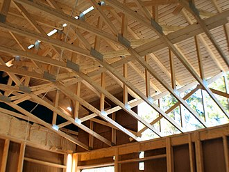 Domestic roof construction - A truss roof with tongue and groove sheathing. The gap in the sheathing at the ridge is the space designed to allow natural ventilation.