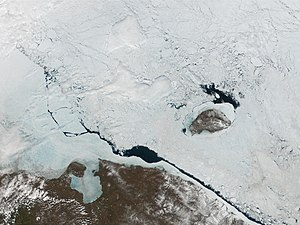 Pevek - Chaunskaya Bay under ice. Pevek Peninsula is visible on the east side of the Bay. To the northeast is Wrangel Island.