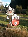 Wurzelrudi mit Wappen von Johanngeorgenstadt.jpg
