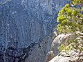 Yosemite Point. View down to west, note climber on top of Lost Arrow and the trail switchbacks at the base of the wall. - panoramio.jpg