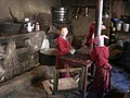Young monks finish their lunch in kitchen of Kye Monastery.jpg