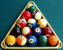 15 pool balls in a triangle: 1 and 5 balls in the corners