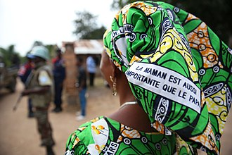 Women in Africa - A Congolese woman defends and promotes the rights of women via a message printed on the fabric she wears, 2015.