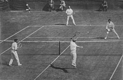 1912 International Lawn Tennis Challenge (Davis Cup) finals match between Australasia and the British Isles played at the Albert Ground in Melbourne, Australia on 28–30 November. Players shown on the near side are Alfred Dunlop (left) and Norman Brookes (right) for Australasia and on the far side James Parke (left) and Alfred Beamish (right) for the British Isles.