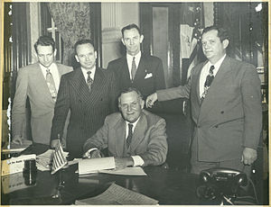 Lamar University - Rep. Jack Brooks is at far left. Governor Beauford Jester is seated. Sen W. R. Cousins, Jr is at far right. Austin, Texas.
