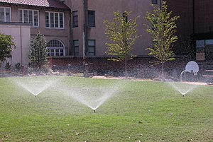 English: Lawn sprinklers in operation at the in .