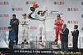 2014 Chinese Grand Prix - Lewis Hamilton holding winners' trophy with Nico Rosberg and Fernando Alonso.jpg
