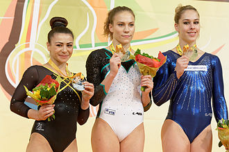 Giulia Steingruber - Steingruber (right) with Claudia Fragapane (left) and Ksenia Afanasyeva (centre) on the floor exercise podium at the 2015 European Championships.