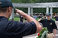 2015 Law Enforcement Explorers Conference saluting a wreath from behind.jpg