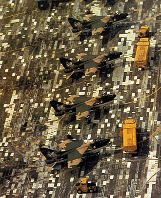 Military camouflage - A-7D Corsairs in a disruptive pattern, countershaded with white, on a disruptively painted surface, Thailand, 1972.