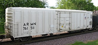 "Refrigerator car - A modern refrigerator car.  The mechanical refrigeration unit is housed behind the grill at the lower right, the car's ""A"" end."