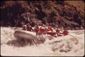 A LARGE (28 FOOT) RAFT RUNNING WILD SHEEP RAPIDS ON THE SNAKE RIVER DURING A CONSERVATION TRIP THROUGH HELLS CANYON - NARA - 549462.tif