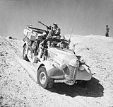 A Long Range Desert Group Chevrolet 30cwt 1533 truck negotiates the slope of a sand dune during a patrol in the desert, 27 March 1941. E2298.jpg