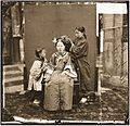 A Manchu lady having her hair dressed by her servant girl Wellcome L0056449.jpg