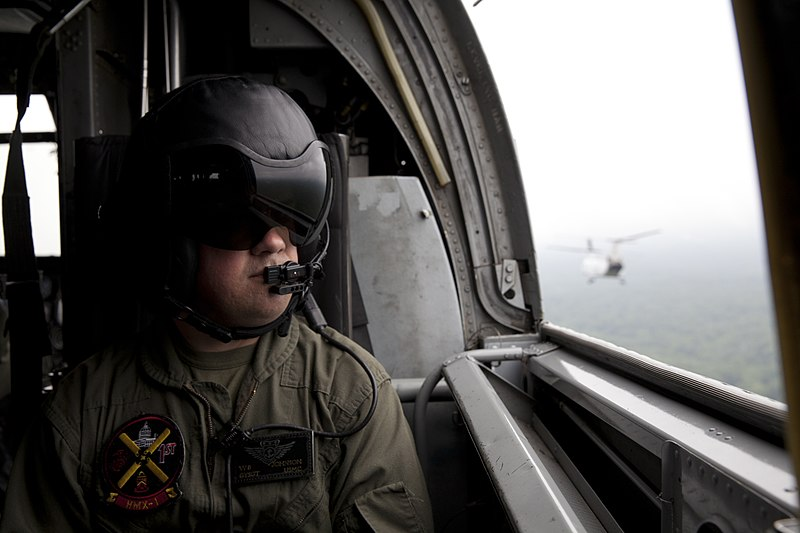 File:A U.S. Marine Corps crew member rides in a Marine Corps CH-46 Sea Knight helicopter while flying members of a Marine Corps Executive Forum (MCEF) over the National Capital Region, July 11, 2013 130711-M-MI461-210.jpg
