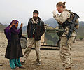 A US Army (USA) Soldier from the Asadabad Provincial Reconstruction Team of the Combined Joint Civil Military Operations Task Force (CJCMOTF), entertains a child by dancing in Manoi, Afghanistan (AFG), during 050114-A-UK569-018.jpg