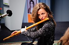 A woman playing bansuri