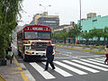 A bus waiting at a pedestrian crossing in Lima.jpg