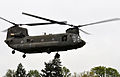 A crew member with the Oregon Army National Guard's aviation unit asses a landing site from aboard a CH 47 Chinook helicopter before landing at Alton Baker Park in Eugene, Ore., May 2, 2012, during a mass 120502-A-NY487-594.jpg