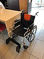 A wheelchair beside a desk.jpg