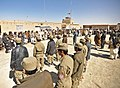 Afghan Local Police candidates and village elders in the Nawbahar district of Zabul province, Afghanistan, listen to district Gov 120307-N-UD522-079.jpg