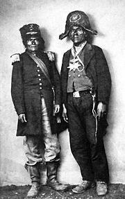 A black and white photograph of two Native Americans wearing military-style uniforms