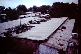 Ahmedabad-India-slums-1979-IHS-89-24-Corrugated-iron-roofs.jpeg