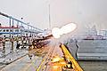Airborne artillerymen salute USS Anchorage 130504-A-ZD229-374.jpg