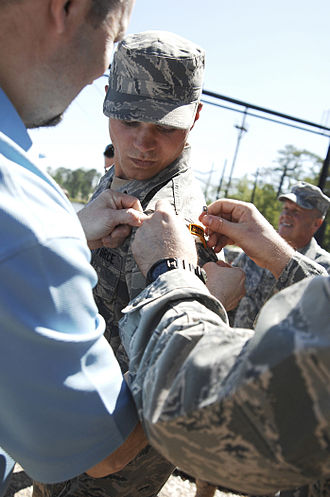 Ranger School - An Airman 1st Class from the 823rd Base Defense Squadron receives his Ranger Tab after completing Ranger School (April 2011).
