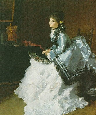 Polonaise (clothing) - Portrait of Mimi Cramer by Albert von Keller, 1875. The sitter wears a blue silk polonaise basque over a white underskirt.