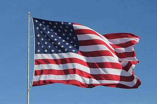 American Flag Waving on a Flag Pole
