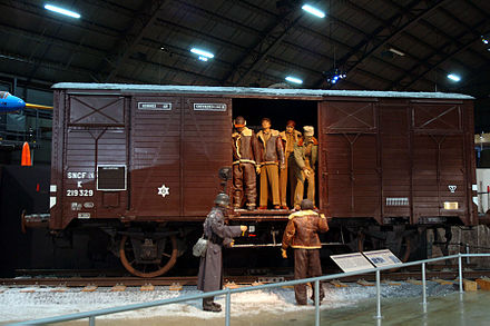 "Representation of a ""Forty-and-eight"" boxcar used to transport American POWs in Germany during World War II. American POWs AF Museum.jpg"
