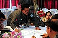 An Afghan National Police (ANP) officer writes down recruiting ideas during an ANP female recruiting conference (4329927149).jpg