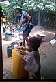 An African child playing in the kitchen.jpg