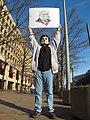 Anonymous demonstrator at FBI Building (10071737945).jpg