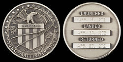 Apollo 16 mission emblem and crew names (front). Dates (launch, lunar landing, and return) (back)