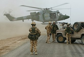 History of Iraq (2003–2011) - A Lynx Helicopter of the British Army Air Corps ready to touch down on a desert road south of Basra Airport, November 2003