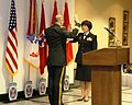 Army Reserve Maj. Gen. William M. Buckler, Jr., commander of 412th Theater Engineer Command in Vicksburg, Miss., administers the Reaffirmation of Oath to Brig. Gen. Miyako Schanely in a ceremony at Fort Drum.jpg