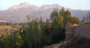 "Arshoq Castle, a.k.a. Kohneh Qaleh (""old castle"") in Meshgin Shahr. Mount Sabalan is in the background"