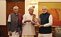 Atmatirtham, a book on Adi Sankara's life and teachings, presented to PM Narendra Modi.jpg