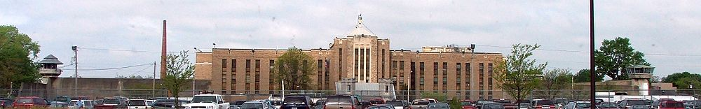 The current front of Auburn Prison. Note the two guard towers on either side and Copper John on top