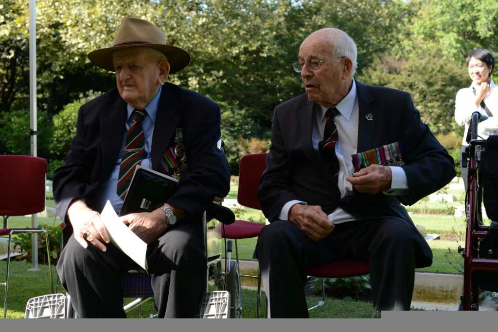 Australian World War II veterans and their families participate in a wreath-laying ceremony to honor fallen comrades and strengthen ties between the Australians and the Japanese in Hodogaya, Japan, Oct. 3 131003-N-KL617-037