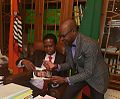 Author Anthony Mukwita gives President Edgar Lungu a copy of the Against All Odds book.jpg