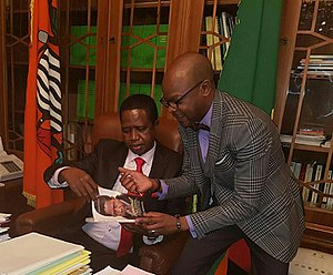 Against All Odds (biography) - Author Anthony Mukwita gives President Edgar Lungu a copy of Against All Odds in January 2017