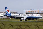 B-2343 - Chongqing Airlines - Airbus A320-233 - TAO (14918752270).jpg