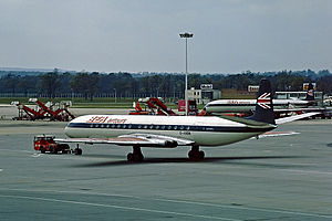 """British Airtours - A BEA Airtours de Havilland Comet 4B wearing the original, late 60s/early 70s BEA """"Speedjack""""-derived livery, seen at London Gatwick Airport in May 1973."""
