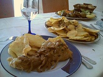 Portuguese cuisine - Bacalhau à minhota, which is one of the Portuguese bacalhau dishes