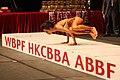 Balancing act at 2012 Hong Kong Bodybuilding Championship.jpg